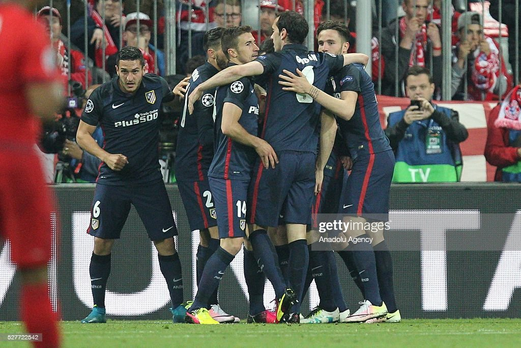 Antoine Griezmann of Atletico Madrid celebrates with teammates after scoring a goal during the Champions League semifinal second leg soccer match between FC Bayern Munich and Atletico Madrid at the Allianz Arena on May 3, 2016, in Munich, Germany.