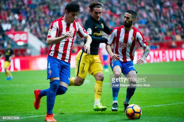 Antoine Griezmann of Atletico Madrid duels for the ball with Jorge Mere of Real Sporting de Gijon during the La Liga match between Real Sporting de...