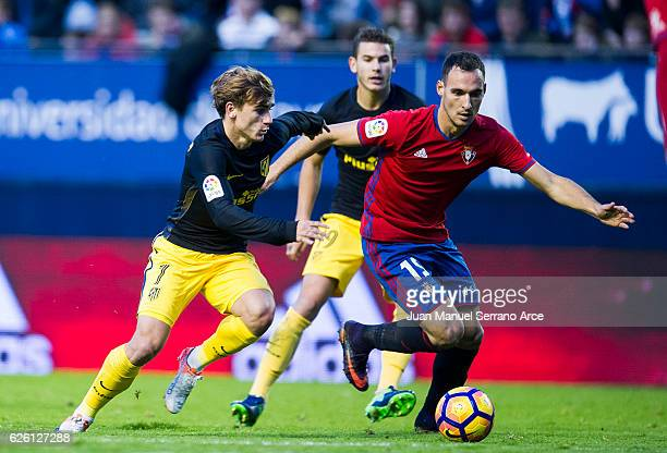 Antoine Griezmann of Atletico Madrid duels for the ball with Kenan Kodro of CA Osasuna during the La Liga match between CA Osasuna and Atletico...