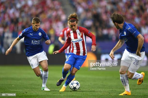 Antoine Griezmann of Atletico Madrid holds off pressure from Marc Albrighton of Leicester City during the UEFA Champions League Quarter Final first...