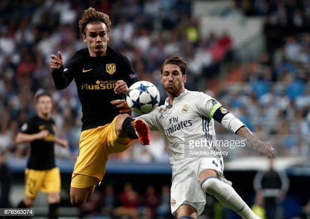 Antoine Griezmann of Atletico Madrid in action against Sergio Ramos of Real Madrid during UEFA Champions League semi final match between Real Madrid...