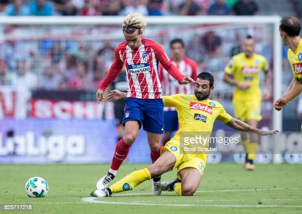 Antoine Griezmann of Atletico Madrid is challenged by Raul Albiol of SSC Napoli during the Audi Cup 2017 match between Club Atletico de Madrid and...