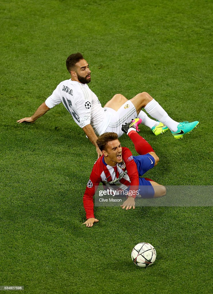 <a gi-track='captionPersonalityLinkClicked' href=/galleries/search?phrase=Antoine+Griezmann&family=editorial&specificpeople=7197539 ng-click='$event.stopPropagation()'>Antoine Griezmann</a> of Atletico Madrid is fouked by Sergio Ramos of Real Madrid during the UEFA Champions League Final match between Real Madrid and Club Atletico de Madrid at Stadio Giuseppe Meazza on May 28, 2016 in Milan, Italy.