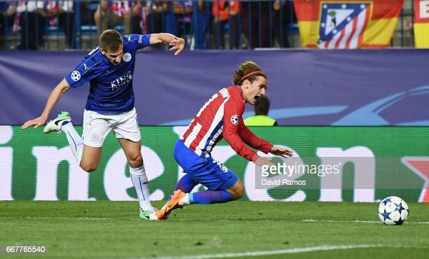 Antoine Griezmann of Atletico Madrid is fouled in the penalty area by Marc Albrighton of Leicester City during the UEFA Champions League Quarter...