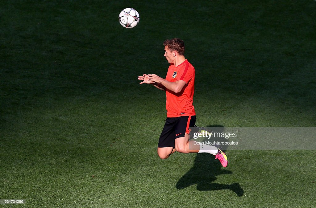 <a gi-track='captionPersonalityLinkClicked' href=/galleries/search?phrase=Antoine+Griezmann&family=editorial&specificpeople=7197539 ng-click='$event.stopPropagation()'>Antoine Griezmann</a> of Atletico Madrid jumps to head the ball during an Atletico de Madrid training session on the eve of the UEFA Champions League Final against Real Madrid at Stadio Giuseppe Meazza on May 27, 2016 in Milan, Italy.