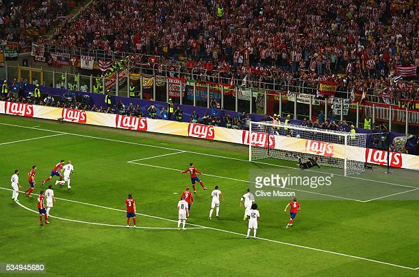 Antoine Griezmann of Atletico Madrid missing a penalty by hitting his shot against the bar during the UEFA Champions League Final match between Real...