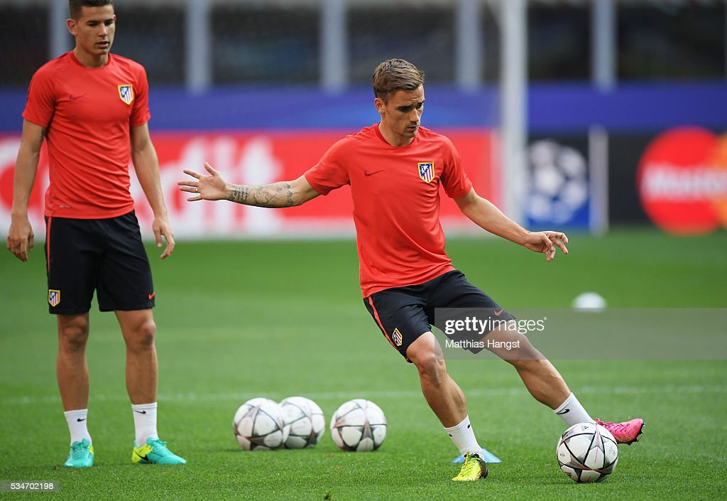 <a gi-track='captionPersonalityLinkClicked' href=/galleries/search?phrase=Antoine+Griezmann&family=editorial&specificpeople=7197539 ng-click='$event.stopPropagation()'>Antoine Griezmann</a> of Atletico Madrid passes theball during an Atletico de Madrid training session on the eve of the UEFA Champions League Final against Real Madrid at Stadio Giuseppe Meazza on May 27, 2016 in Milan, Italy.