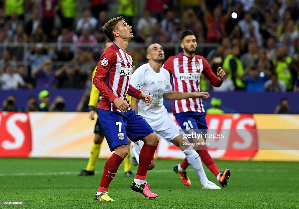<a gi-track='captionPersonalityLinkClicked' href=/galleries/search?phrase=Antoine+Griezmann&family=editorial&specificpeople=7197539 ng-click='$event.stopPropagation()'>Antoine Griezmann</a> of Atletico Madrid reacts after missing a penalty during the UEFA Champions League Final match between Real Madrid and Club Atletico de Madrid at Stadio Giuseppe Meazza on May 28, 2016 in Milan, Italy.