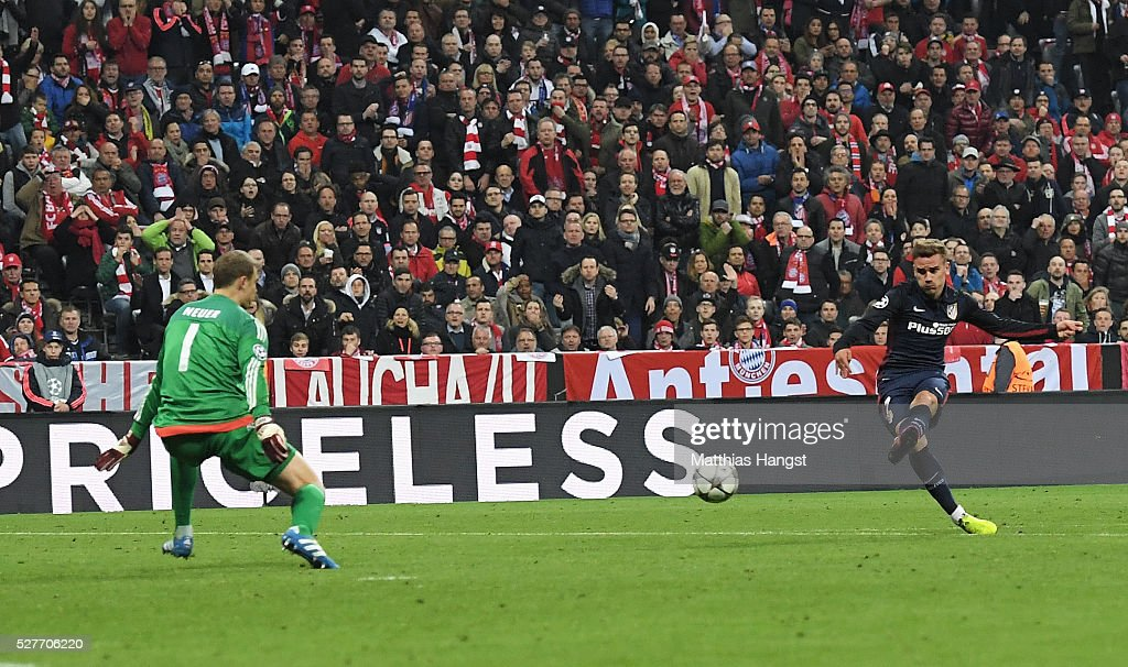Antoine Griezmann of Atletico Madrid (7) shoots past goalkeeper Manuel Neuer of Bayern Munich to score their first goal during UEFA Champions League semi final second leg match between FC Bayern Muenchen and Club Atletico de Madrid at Allianz Arena on May 3, 2016 in Munich, Germany.