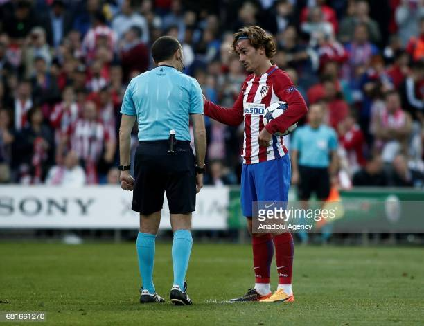 Antoine Griezmann of Atletico Madrid speaks with referee Cuneyt Cakir before he uses penalty kick during the UEFA Champions League semi final second...