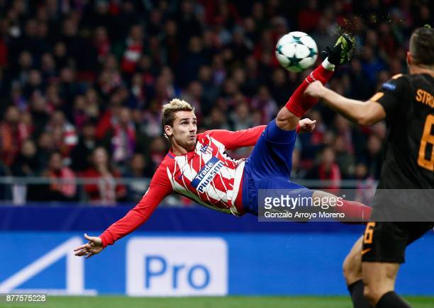 Antoine Griezmann of Atletico Madrid volleys to score his team's opening goal during the UEFA Champions League group C match between Atletico Madrid...