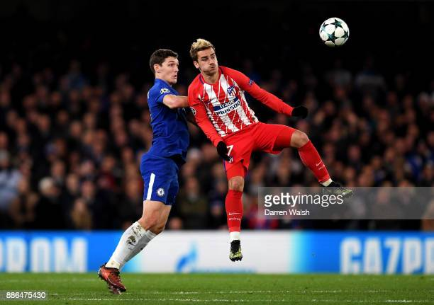 Antoine Griezmann of Atletico Madrid wins a header over Andreas Christensen of Chelsea during the UEFA Champions League group C match between Chelsea...
