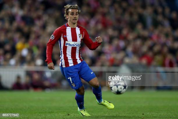 Antoine Griezmann of Atletico runs with the ball during the UEFA Champions League Round of 16 second leg match between Club Atletico de Madrid and...