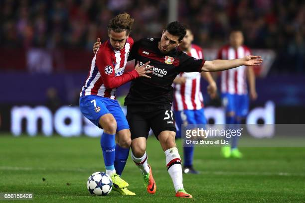 Antoine Griezmann of Club Atletico de Madrid battles with Kevin Volland of Bayer Leverkusen during the UEFA Champions League Round of 16 second leg...