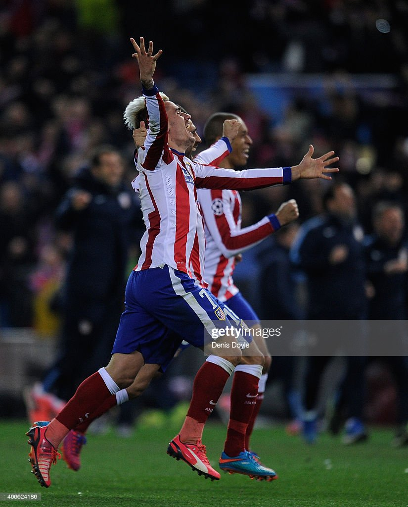 Antoine Griezmann of Club Atletico de Madrid celebrates after his team won in the penalty shoot-out after extra time in the the UEFA Champions League Round of 16 2nd leg match between Club Atletico de Madrid and Bayer 04 Leverkusen at the Vicente Calderon stadium on March 17, 2015 in Madrid, Spain.