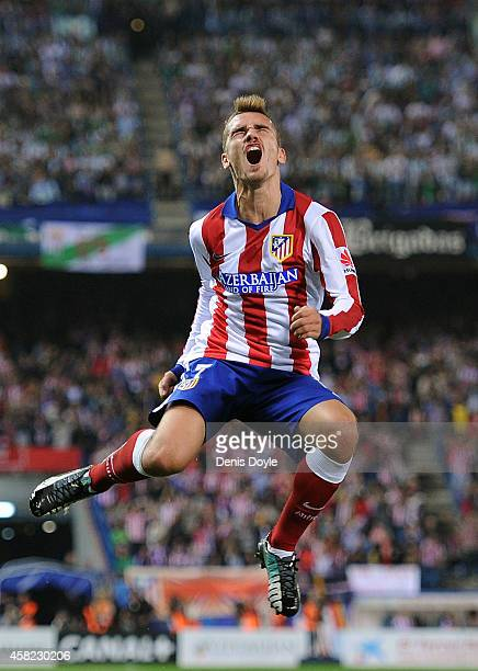 Antoine Griezmann of Club Atletico de Madrid celebrates after scoring his team's opening goal during the La Liga match between Club Atletico de...