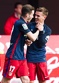 Antoine Griezmann of Club Atletico de Madrid celebrates with his teammate Saul Niguez of Club Atletico de Madrid after scoring the opening goal...