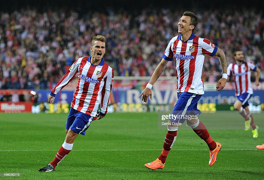 <a gi-track='captionPersonalityLinkClicked' href=/galleries/search?phrase=Antoine+Griezmann&family=editorial&specificpeople=7197539 ng-click='$event.stopPropagation()'>Antoine Griezmann</a> of Club Atletico de Madrid celebrates with <a gi-track='captionPersonalityLinkClicked' href=/galleries/search?phrase=Mario+Mandzukic&family=editorial&specificpeople=4476149 ng-click='$event.stopPropagation()'>Mario Mandzukic</a> after scoring his team's opening goal during the La Liga match between Club Atletico de Madrid and Cordoba CF at Vicente Calderon Stadium on November 1, 2014 in Madrid, Spain.