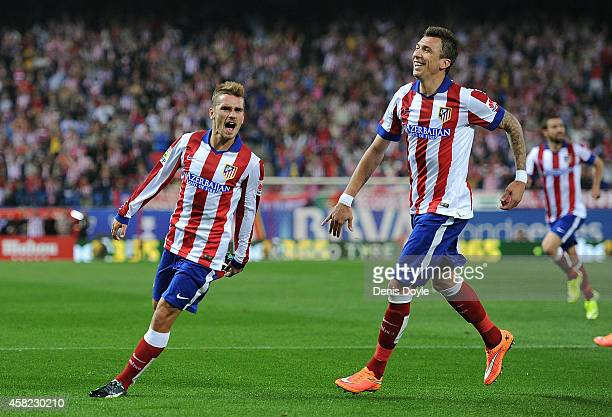 Antoine Griezmann of Club Atletico de Madrid celebrates with Mario Mandzukic after scoring his team's opening goal during the La Liga match between...