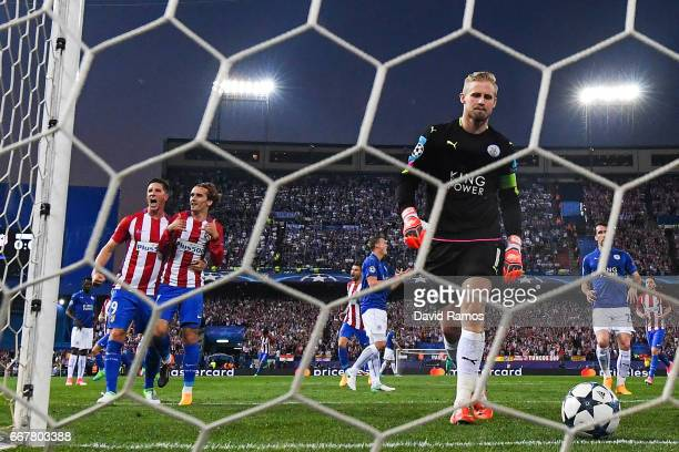 Antoine Griezmann of Club Atletico de Madrid celebrates with team mate Fernando Torres after scoring the opening goal as Kasper Schmeichel of...