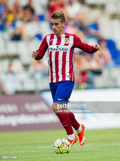 Antoine Griezmann of Club Atletico de Madrid controls the ball during a pre season friendly match between Real Oviedo and Club Atletico de Madrid at...