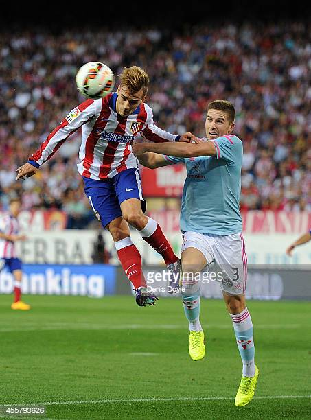 Antoine Griezmann of Club Atletico de Madrid gets to the ball ahead of Andreu Fontas of Real Club Celta de Vigo during the La Liga match at the...