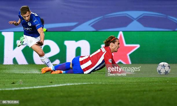 Antoine Griezmann of Club Atletico de Madrid is fouled in the penalty area by Marc Albrighton of Leicester City during the UEFA Champions League...