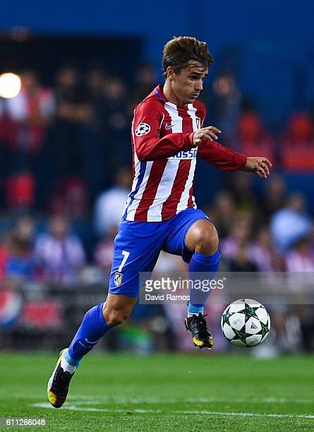 Antoine Griezmann of Club Atletico de Madrid runs with the ball during the UEFA Champions League Group D match between Club Atletico de Madrid and FC...