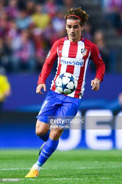 Antoine Griezmann of Club Atletico de Madrid runs with the ball during the UEFA Champions League Quarter Final first leg match between Club Atletico...