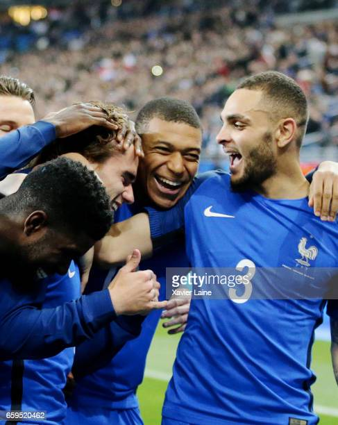 Antoine Griezmann of France celebrate his disallowed goal with Kylian Mbappe and Layvin Kurzawa during the Friendly game between France and Spain at...