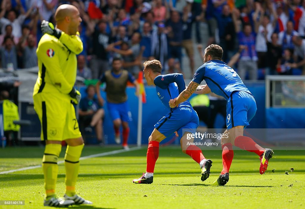 Antoine Griezmann (C) of France celebrates after scoring a goal during the UEFA Euro 2016 Round of 16 football match between France and Ireland at the Stade de Lyon in Lyon, France on June 26, 2016.