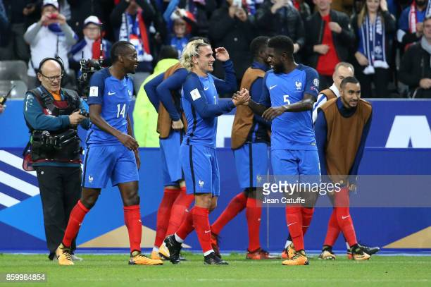 Antoine Griezmann of France celebrates his goal with Blaise Matuidi Samuel Umtiti during the FIFA 2018 World Cup Qualifier between France and Belarus...