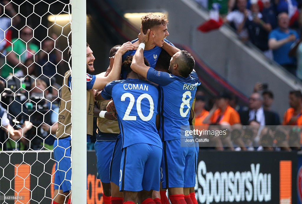 Antoine Griezmann of France celebrates his second goal with teammates during the UEFA EURO 2016 round of 16 match between France and Republic of Ireland at Stade des Lumieres, Parc OL on June 26, 2016 in Lyon, France.