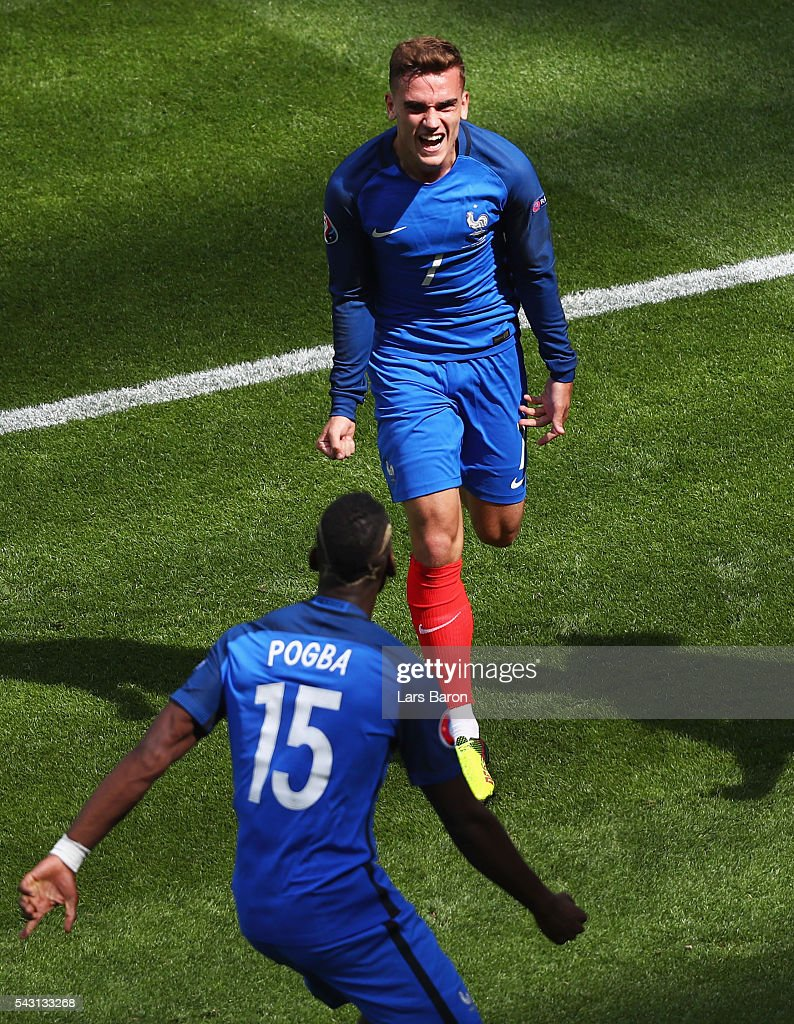 Antoine Griezmann (top) of France celebrates scoring his team's first goal with his team mate Paul Pogba (bottom) during the UEFA EURO 2016 round of 16 match between France and Republic of Ireland at Stade des Lumieres on June 26, 2016 in Lyon, France.