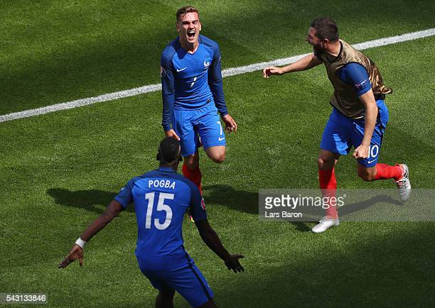 Antoine Griezmann of France celebrates scoring his team's first goal with his team mates Paul Pogba and AndrePierre Gignac during the UEFA EURO 2016...