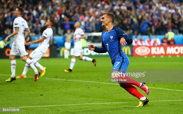 Antoine Griezmann of France celebrates scoring his team's fourth goal during the UEFA EURO 2016 quarter final match between France and Iceland at...