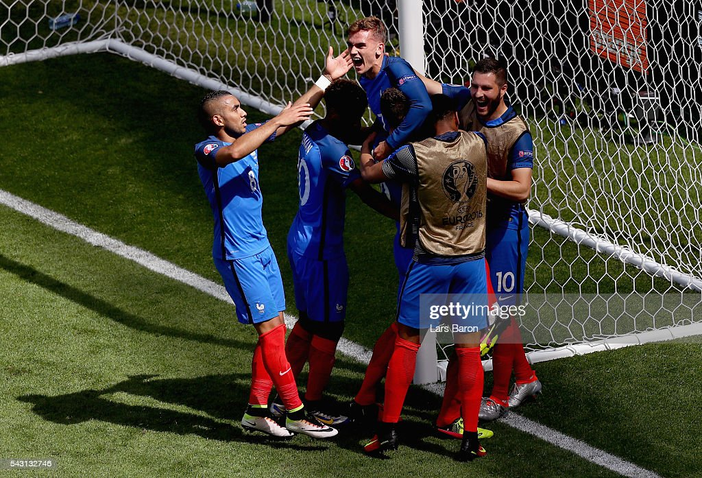 Antoine Griezmann (top) of France celebrates scoring his team's second goal with his team mates during the UEFA EURO 2016 round of 16 match between France and Republic of Ireland at Stade des Lumieres on June 26, 2016 in Lyon, France.