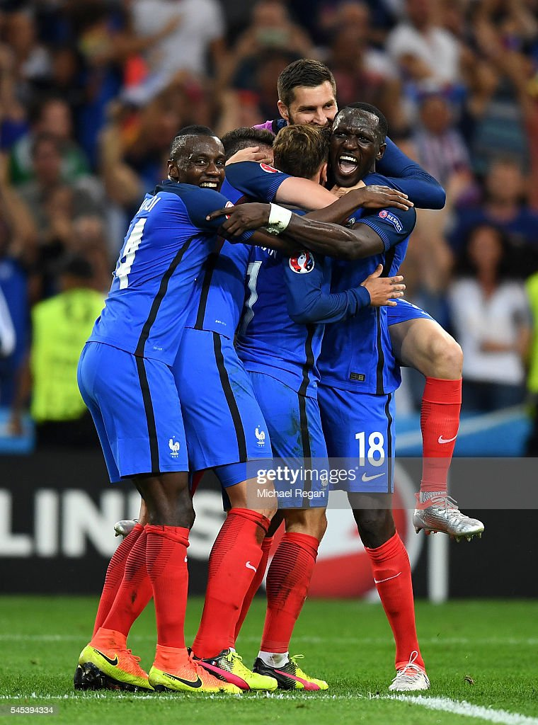 Antoine Griezmann of France celebrates scoring his team's second goal with his team mates during the UEFA EURO semi final match between Germany and...