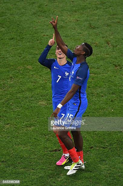 Antoine Griezmann of France celebrates scoring his team's second goal with his team mate Paul Pogba during the UEFA EURO semi final match between...