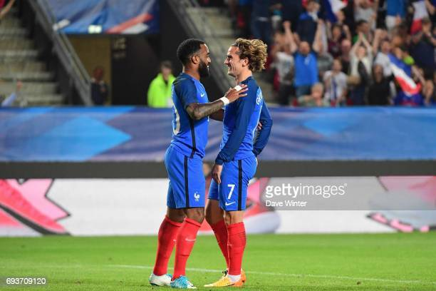 Antoine Griezmann of France celebrates with Alexandre Lacazette of France after putting his side 50 ahead during the soccer friendly match between...