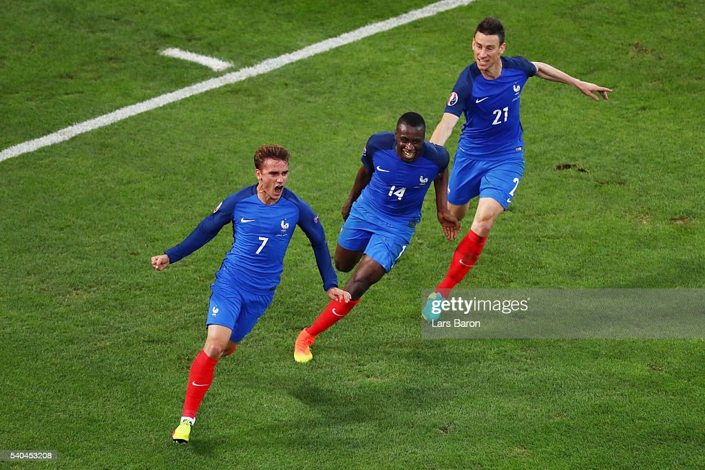 <a gi-track='captionPersonalityLinkClicked' href=/galleries/search?phrase=Antoine+Griezmann&family=editorial&specificpeople=7197539 ng-click='$event.stopPropagation()'>Antoine Griezmann</a> of France celebrates with <a gi-track='captionPersonalityLinkClicked' href=/galleries/search?phrase=Blaise+Matuidi&family=editorial&specificpeople=801779 ng-click='$event.stopPropagation()'>Blaise Matuidi</a> and <a gi-track='captionPersonalityLinkClicked' href=/galleries/search?phrase=Laurent+Koscielny&family=editorial&specificpeople=2637418 ng-click='$event.stopPropagation()'>Laurent Koscielny</a> after scoring his sides first goal during the UEFA EURO 2016 Group A match between France and Albania at Stade Velodrome on June 15, 2016 in Marseille, France.