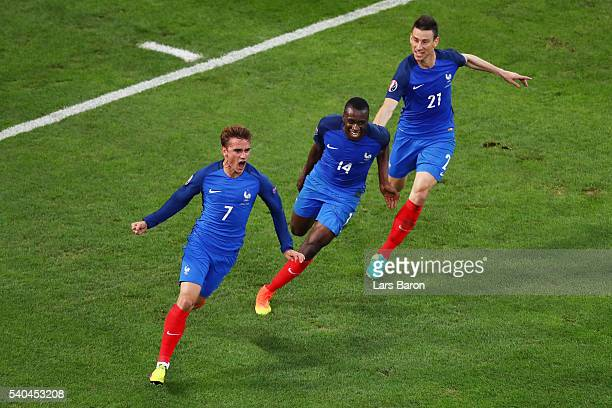 Antoine Griezmann of France celebrates with Blaise Matuidi and Laurent Koscielny after scoring his sides first goal during the UEFA EURO 2016 Group A...