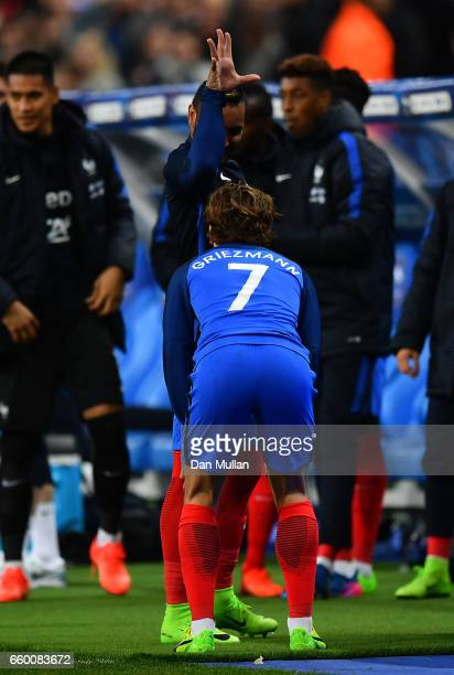 Antoine Griezmann of France celebrates with Dimitri Payet of France after scoring a goal only for it to be ruled out for offside by the video referee...
