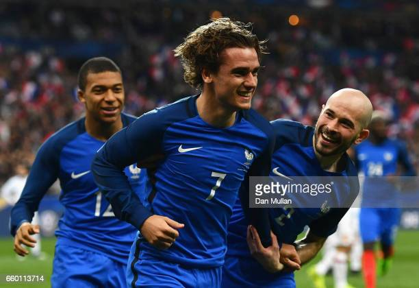 Antoine Griezmann of France celebrates with team mates after scoring only for the goal to be disallowed during the International Friendly match...