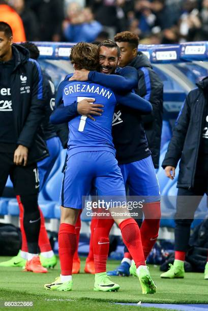 Antoine Griezmann of France gives a hug to Dimitri Payet of France during the International Friendly game between France and Spain at Stade de France...