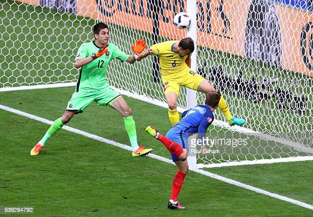 Antoine Griezmann of France heads the ball hitting a post during the UEFA Euro 2016 Group A match between France and Romania at Stade de France on...