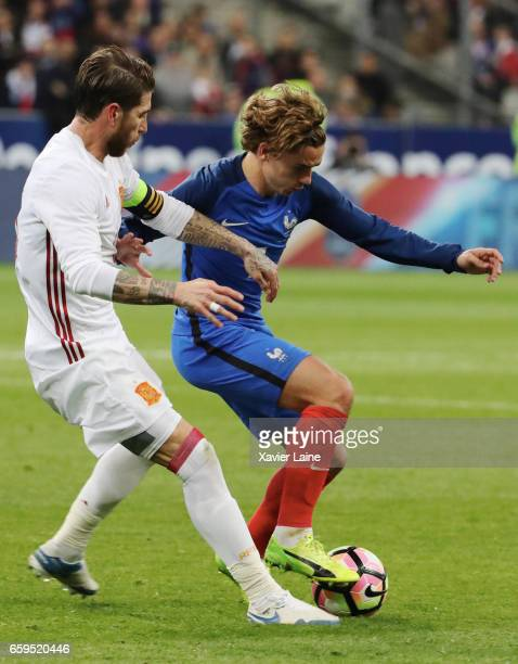 Antoine Griezmann of France in action with Sergio Ramos of Spain during the Friendly game between France and Spain at Stade de France on march 28...