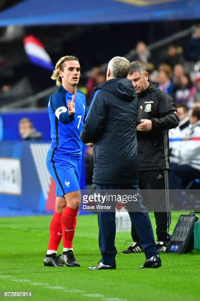 Antoine Griezmann of France is substituted by France coach Didier Deschamps during the international friendly match between France and Wales at Stade...