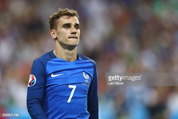 Antoine Griezmann of France reacts after missing with a header on goal during the UEFA EURO 2016 Final match between Portugal and France at Stade de...