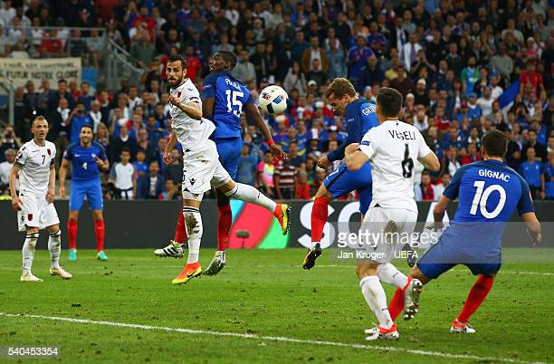 Antoine Griezmann of France scores his sides first goal during the UEFA EURO 2016 Group A match between France and Albania at Stade Velodrome on June...